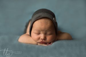 Baby with Head on hands Newborn baby photography Dublin Meath Kildare Wicklow