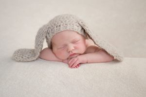 newborn photography - baby posed in cosy hat