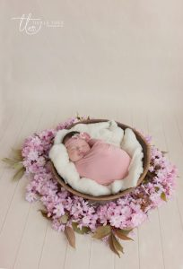Baby swaddled in Cherry Blossom Newborn baby photography Dublin Meath Kildare Wicklow