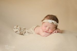 Newborn baby posed with cream wrap Tickle Toes Newborn baby photography Dublin Meath Kildare Wicklow